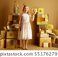 smiling young little princess showing golden gift card 55176279