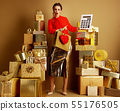 shopper woman with shopping bag and red heart pointing at big wh 55176505