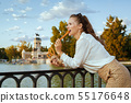 tourist woman in Madrid, Spain eating traditional Spain churro 55176648