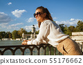 woman at El Retiro Park in Madrid, Spain looking into distance 55176662