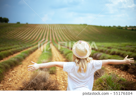modern child in green field in Provence, France rejoicing 55176884