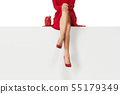 legs woman wearing high heels shoes sitting on bench. 55179349