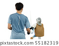 Selected focus hand holidng sword practicing with target mannequin. 55182319