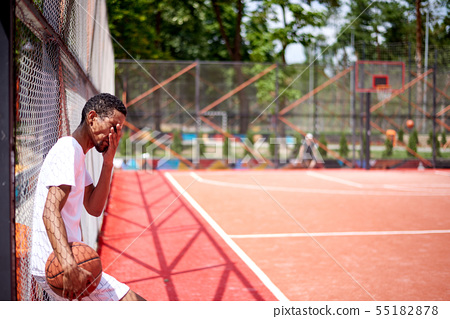 Black basketball player posing in the field 55182878