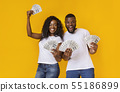 Lucky afro man and woman holding winning money 55186899