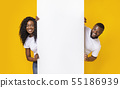 African couple posing with white empty board 55186939