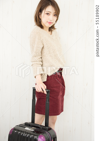 A woman with a suitcase 55189902