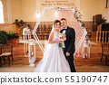 Baeutiful wedding couple in the church. Just married groom and bride. Family 55190747