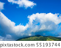 White clouds covering the top of the mountain Blue sky 55193744