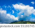 White clouds covering the top of the mountain Blue sky 55193745