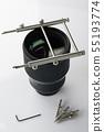 Metal tool on top of big lens 55193774