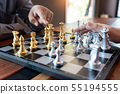 Business man moving chess game for business 55194555