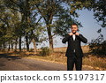 Handsome groomm dressed a tie bow. Wedding day. Man outside. Young man smile 55197317