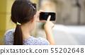 Girl is using smartphone 55202648