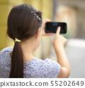 Girl is using smartphone 55202649