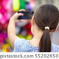 Girl is using smartphone 55202650