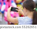 Girl is using smartphone 55202651