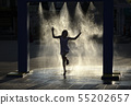 Girl is enjoying spray with cold water 55202657