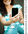 Woman is using her smartphone 55202713