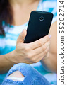 Woman is using smartphone 55202714