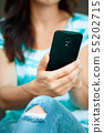 Woman is using smartphone 55202715