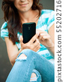 Woman is using smartphone 55202716