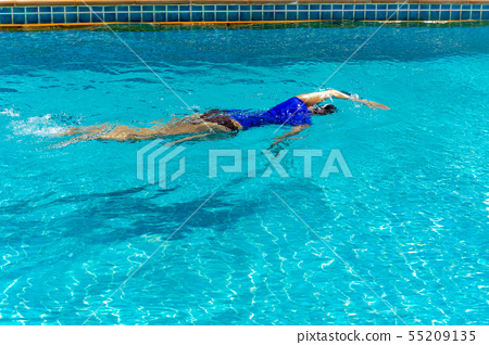 female swimmer training in the swimming pool. 55209135
