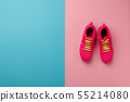 A studio shot of pair of running shoes on pink background. Flat lay. 55214080