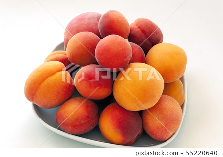 Isolated fresh juicy peaches fruits and ripe apricots isolated on white plate. Summer fruit concept 55220640