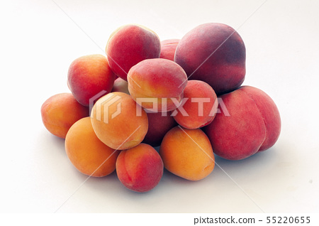 Fresh juicy peaches fruits and ripe apricots isolated on white background. Summer fruit concept 55220655