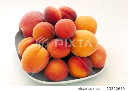 Isolated fresh juicy peaches fruits and ripe apricots isolated on white plate. Summer fruit concept 55220659