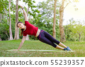 Side view of happy young athlete woman stretching 55239357