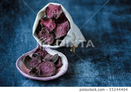 vegetarian pile of healthy beet chips Purple Baked 55244404