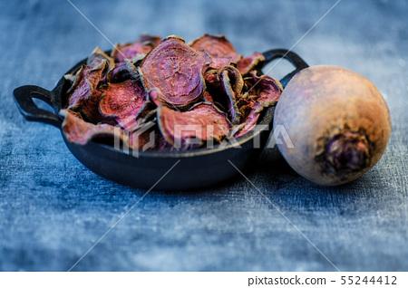 vegetarian pile of healthy beet chips Purple Baked 55244412