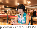 woman talk on cellphone at a coffee shop 55249351