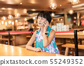 woman talk on cellphone at a coffee shop 55249352