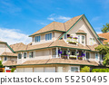 Top of big luxury residential house on blue sky 55250495