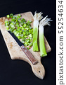Fresh green organic chopped onions and knife on a 55254634