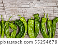 Fresh green raw peppers on rustic wooden table 55254679