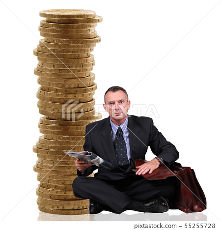 man sitting near a stack of coins 55255728