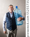 man  with a giant water bottle 55255735