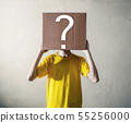 Person with overhead a cardboard box 55256000