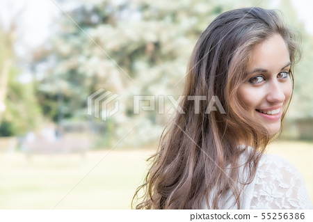 smiling girl in the park 55256386