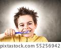 boy is brushing his teeth 55256942