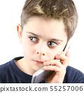 Afraid little boy speaking on the phone in white 55257006