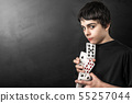 magician with playing cards 55257044