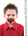 angry young boy in white background 55257174