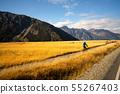 Young man cycling mountain bike along the rural 55267403