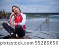 portrait outdoors of a young beautiful woman at 55289650