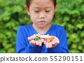 Asian child girl holding some thai sugar 55290151